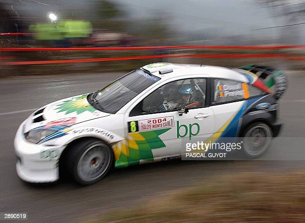 Belgian Francois Duval and his copilot Stephane Prevost take a turn in theri Ford Focus RS WRC 03 during their practice session before the 72nd Monte...
