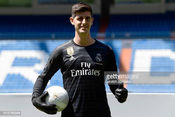 Belgian goalkeeper Thibaut Courtois poses during his presentation as new player of Real Madrid football team at the Santiago Bernabeu stadium in...