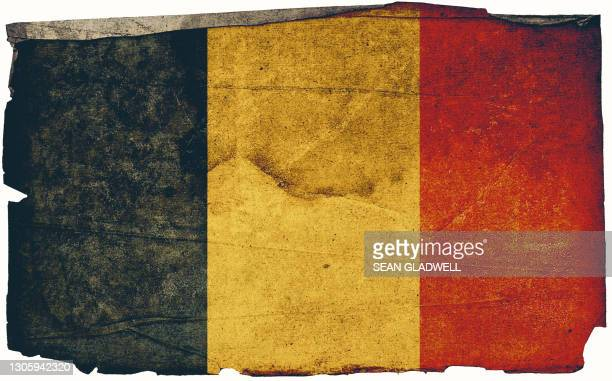 belgian grunge flag poster - insignia stock pictures, royalty-free photos & images