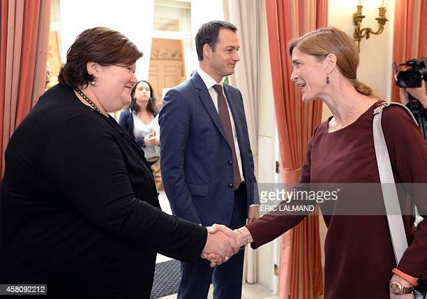 Belgian Health and Social Affairs Minister Maggie De Block shakes hands with US Ambassador to the United Nations Samantha Power on October 30 2014...