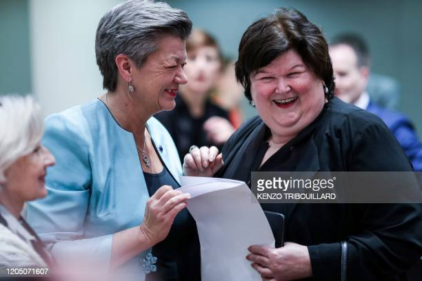 Belgian Health Social Affairs Asylum Policy and Migration minister Maggie De Block speaks with EU commissioner for Home Affairs Ylva Johansson before...