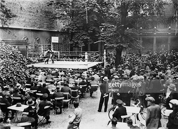 Belgian heavyweight boxer Pierre Charles at his work out in the garden of a cafe Photograph 2081931