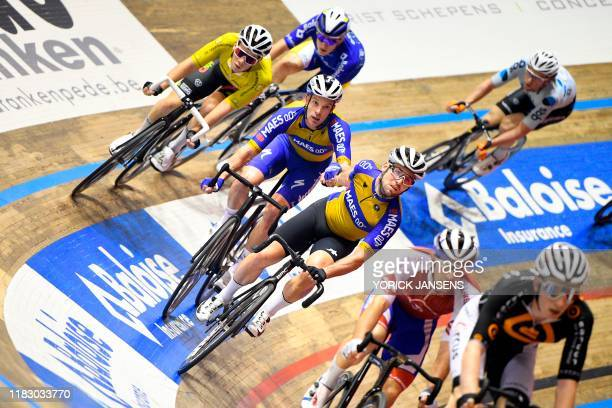 Belgian Iljo Keisse and British Mark Cavendish compete during the final day of the Zesdaagse Vlaanderen-Gent six-day indoor cycling race at the...