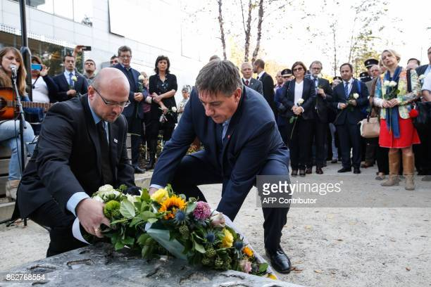 Belgian Interior Minister Jan Jambon lays a wreath during a ceremony in support of victims of terrorism and emergency response services in Brussels...