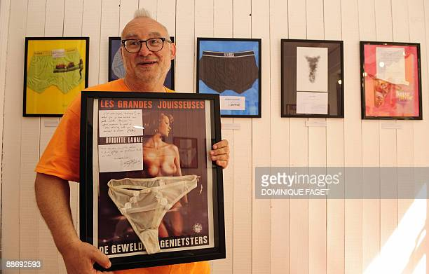 Belgian Jan Bucquoy curator of the underwear museum of Brussels poses on June 25 2009 with a piece of the museum the panties of French porn star...