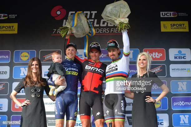 Belgian Jens Keukeleire of Orica Scott, Belgian Greg Van Avermaet of BMC Racing Team and Slovakian Peter Sagan of Bora-Hansgrohe celebrate on the...