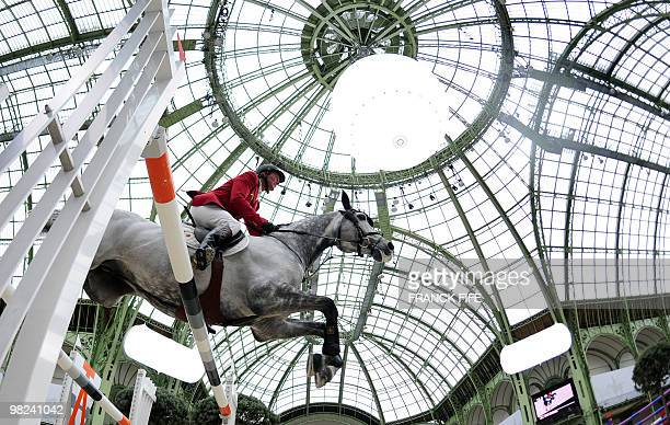 Belgian Jos Lansink riding King Kolibri competes in the International Jumping Competition on April 04 at The Grand Palais in Paris AFP PHOTO / FRANCK...