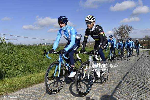 Belgian Jurgen Roelandts and Spanish world champion Alejandro Valverde attend a reconnaissance session with Movistar team mates on April 4 ahead of...