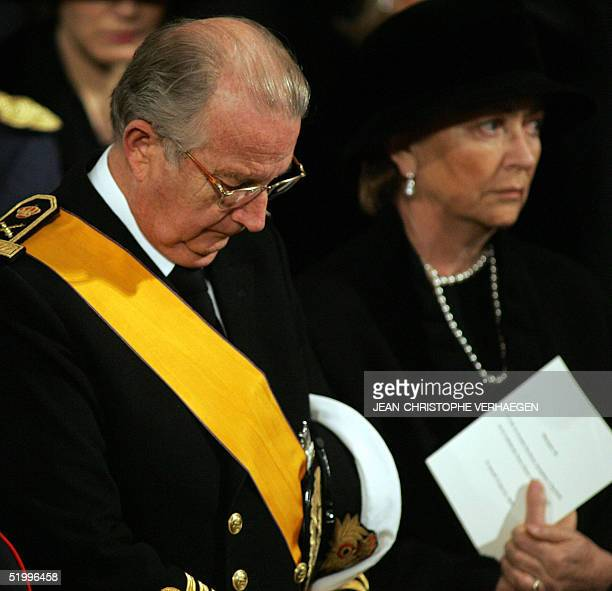 Belgian King Albert II stands next to Queen Paola during the funeral of his sister Luxembourg Grand Duchess Josephine Charlotte in Notre Dame de...