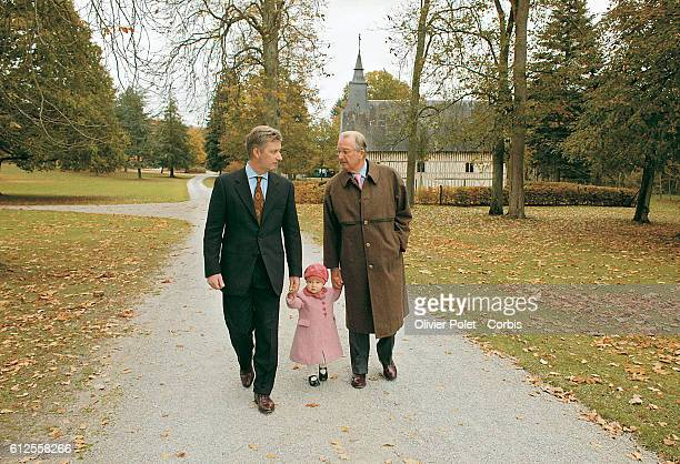 Belgian King Albert walks with Prince Philippe and Princess Elisabeth in the park of Ciergnon after the Princess's baptism