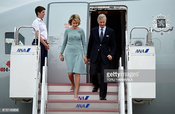 Belgian King Philippe and Queen Mathilde alight from their aircraft upon arrival at Haneda Airport in Tokyo on October 10 2016 The Belgian royal...