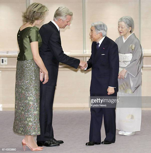 Belgian King Philippe and Queen Mathilde welcome Japanese Emperor Akihito and Empress Michiko as the Japanese imperial couple arrive at a hall in...