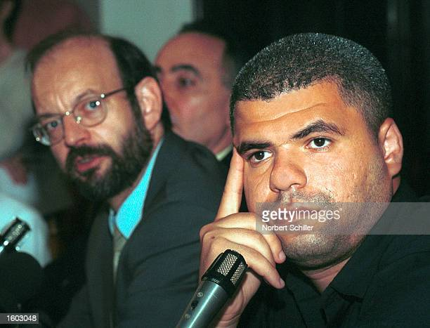 Belgian lawyer Luc Walleyn left addresses a press conference as Palestinian plaintiff Mohamed Abou Roudeina sits beside him July 20 2001 in Cairo...