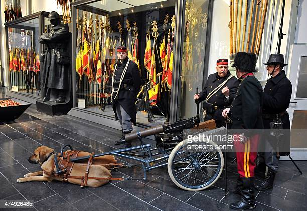 A Belgian machine gun cart pulled by dogs with soldiers dressed in WW1 uniforms is displayed at the Royal Museum of the Army and Military History in...