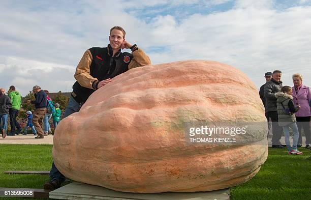 Belgian Mathias Willemijns poses with his atlantic giant pumpkin prior the weightoff at the Giant Pumpkin European Championship in Ludwigsburg...