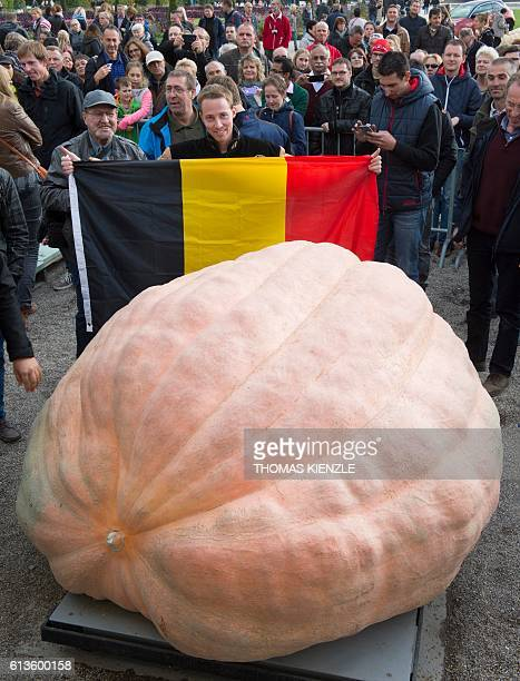 Belgian Mathias Willemijns poses with his winning atlantic giant pumpkin after the weightoff at the Giant Pumpkin European Championship in...