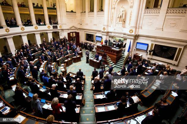 Belgian members of parliament observe a minute of silence in memory of Belgian politician Philippe Maystadt who died earlier on December 7 during a...