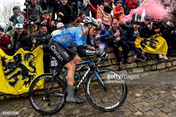 Belgian Michael Goolaerts of Verandas Willems - Crelan competes on the 'Muur van Geraardsbergen' cobblestone road in Geraardsbergen, during the 102nd...