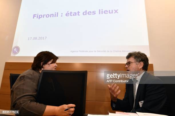 Belgian Minister of Health and Social Affairs Maggie De Block talks with Belgian agency for food security's Directorgeneral Herman Diricks during a...