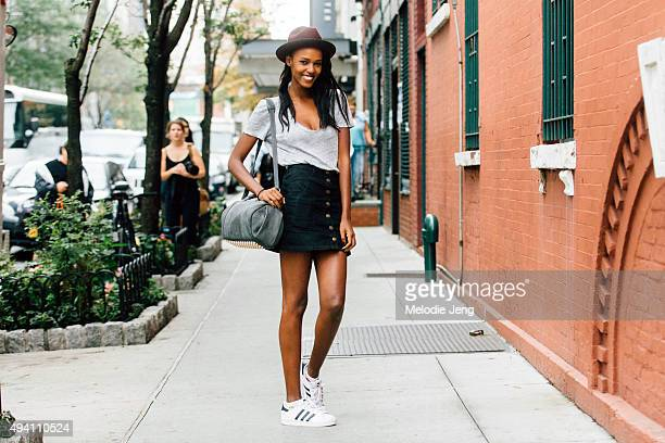 Belgian model Leila Nda exits the Creatures of the Wind show at SIR Stage37 on September 10 2015 in New York City Leila wears a maroon and black...