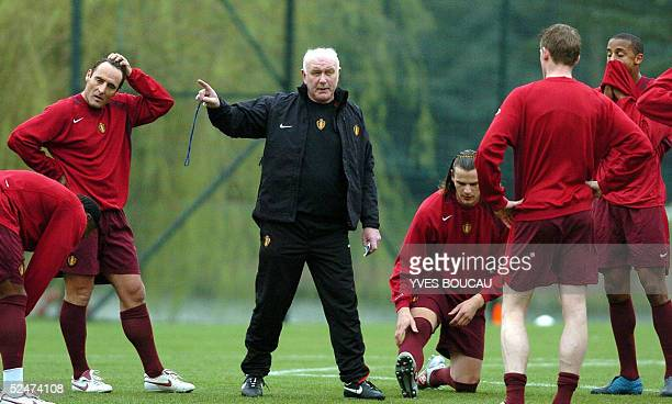 Belgian national coach Aime Anthuenis talks to his players during a training session 24 March 2005 in Kraainem in preparation for their game against...