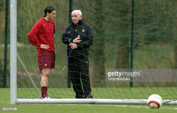 Belgian national coach Aime Anthuenis talks to Luigi Pieroni of Auxerre during a training session 24 March 2005 in Kraainem in preparation for their...