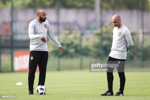 Belgian national football team Red Devils' assistant coach Thierry Henry and head coach Roberto Martinez take part in a training session on May 23 in...