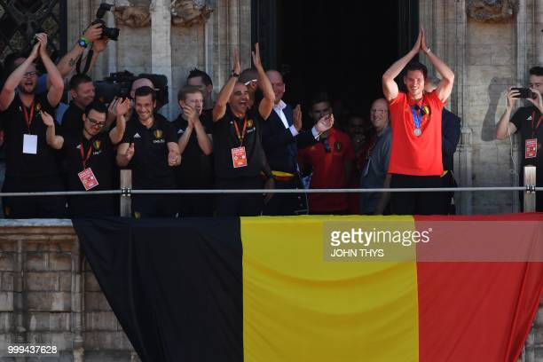 Belgian national football team Red Devils defender Jan Vertonghen celebrates with supporters at the balcony of the city hall in Brussels on July 15...