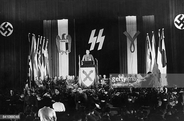 LEON DEGRELLE Belgian Nazi officer Delivering a speech in front of WaffenSS banners on the 'European War Against Bolshevism' at the Palais de...