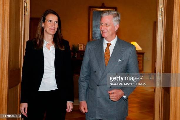 Belgian new Prime Minister Sophie Wilmes and King Philippe Filip of Belgium pose after her appointment on October 27 2019 in Brussels Belgian Budget...