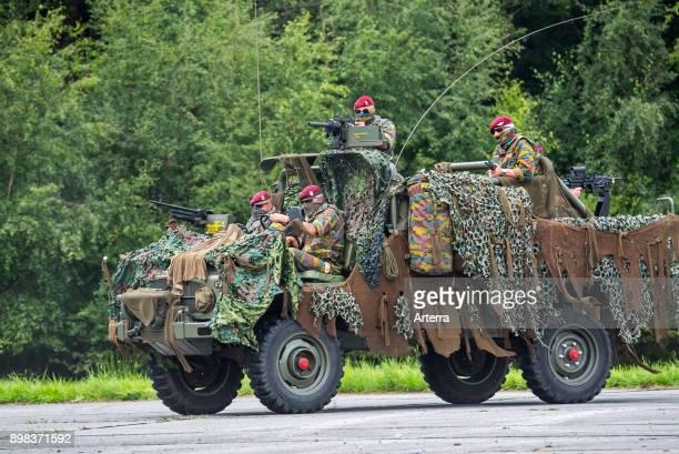 Belgian paracommandos of the ParaCommando Regiment manning camouflaged LRPV armoured vehicle the MercedesBenz Unimog 404