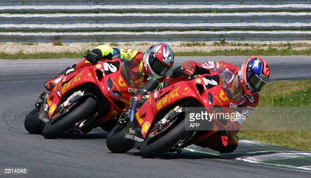 Belgian pilot Stephane Mertens of the Chinese team Zongsen 1 on Suzuki GSXR1000 is chased by Slovenian pilot Igor Jerman on the same bike from the...