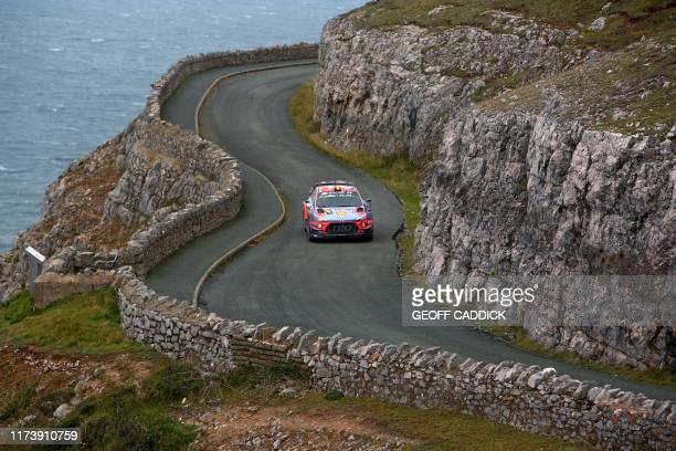 Belgian pilot Thierry Neuville and co pilot Nicolas Gilsoul of the Hyundau Shell Mobis World Rally Team drive their Hyundai i20 Coupe WRC as they...