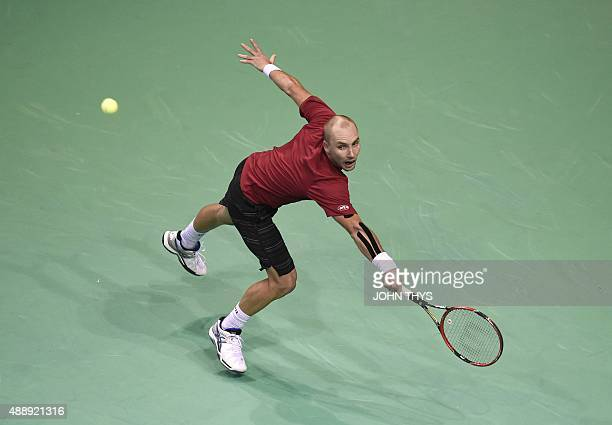 Belgian player Steve Darcis returns the ball to Argentinian player Leonardo Mayer during the Davis cup semi-final tennis match at the Forest National...