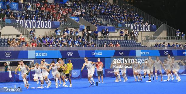 Belgian players celebrate after winning the Tokyo Olympic men's hockey gold medal match against Australia on Aug. 5 at Oi Hockey Stadium in Tokyo.