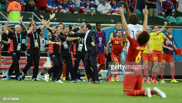 Belgian players celebrate their victory after the World Cup round of 16 soccer match between Belgium and the USA at the Arena Fonte Nova in Salvador...