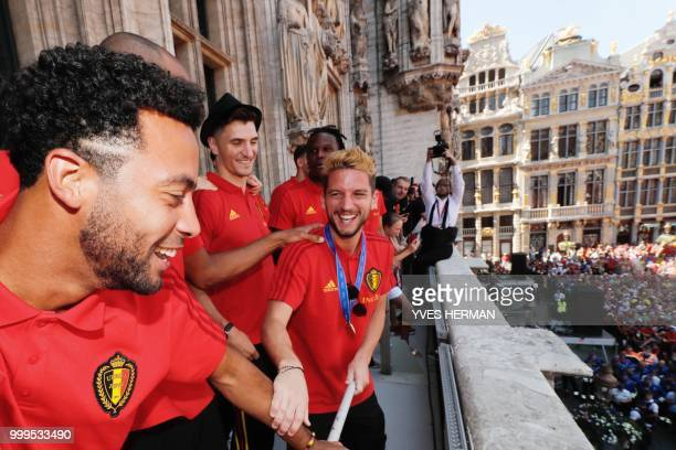 Belgian players Mousa Dembele Thomas Meunier and Dries Mertens celebrate at the balcony in front of more than 8000 supporters at the GrandPlace Grote...