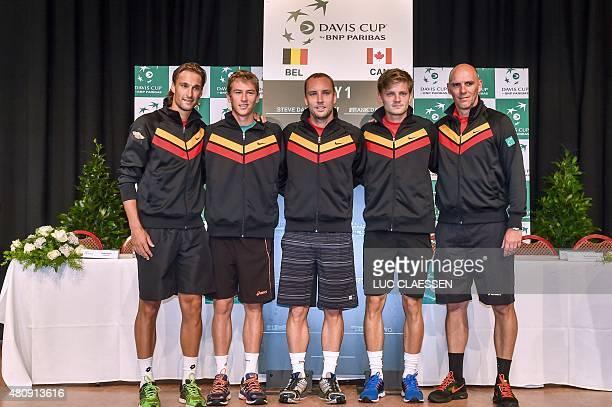 Belgian players Ruben Bemelmans, Kimmer Coppejans, Steve Darcis, David Goffin and captain Johan Van Herck pose during the draw for the upcoming Davis...