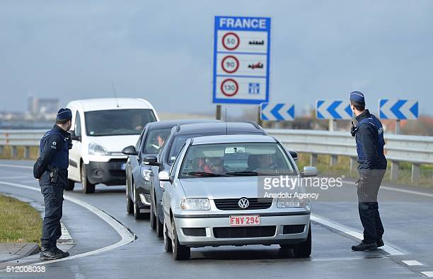 Belgian police check the vehicles to prevent refugee entrance into the country as vehicles cross the border from France into Belgium in De Panne...