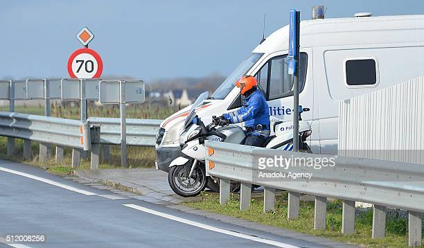 Belgian police check the vehicles to prevent refugee entrance into the country as vehicles cross the border from France into Belgium, in De Panne...