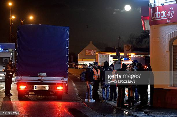Belgian police control a truck at the BelgiumFrance boarder in Adinkerke on February 23 after Belgian government announced earlier in the day to...