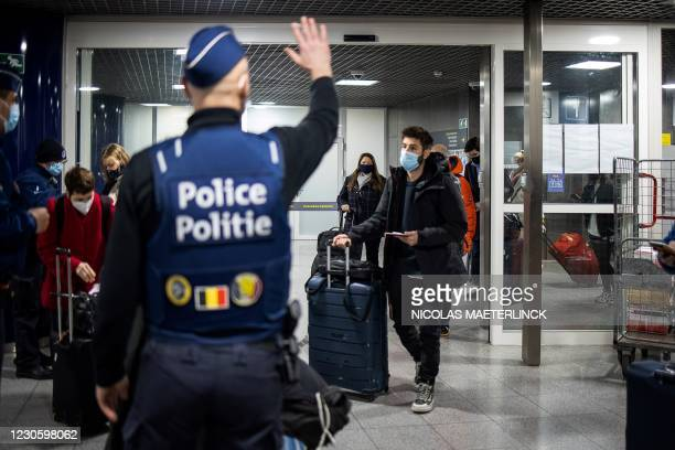 Belgian police officers control travellers of the Eurostar train from London upon their arrival at the Brussel-Zuid or Bruxelles-Midi, train station...
