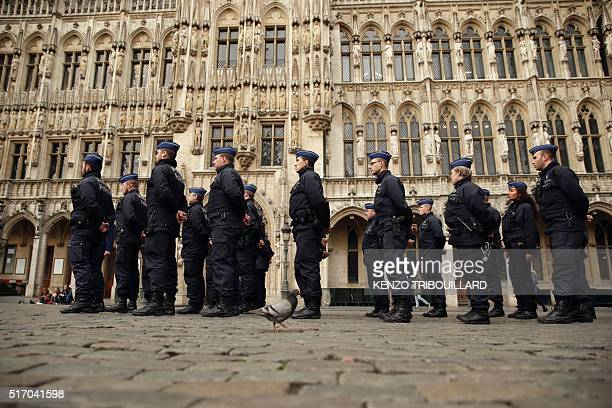 Belgian police officers stand guard at the Grand Place in Brussels on March 23 a day after blasts hit the Belgian capital World leaders united in...