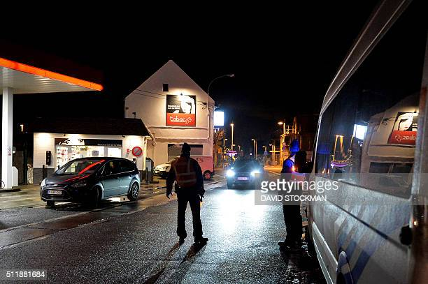 Belgian police officers stand guard during a police border control mission in Adinkerke on February 23 2016 as Belgium Government announced earlier...