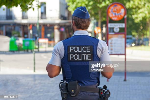 belgian policeman in bulletproof vest - belgium stock pictures, royalty-free photos & images