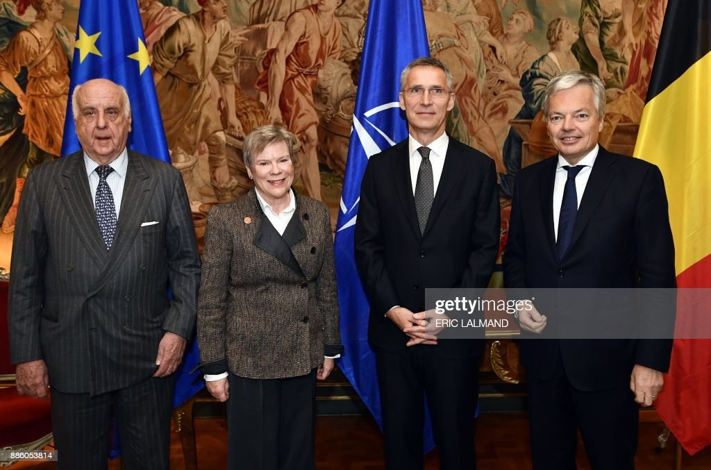 Belgian politician Etienne Davignon, Deputy Secretary General of NATO Rose Gottemoeller, Belgian Foreign Minister Didier Reynders and NATO Secretary General Jens Stoltenberg pose for the photographer during a celebration on the 50th anniversary of the 'Harmel Doctrine', on December 5, 2017 in Brussels. The late Belgian Minister of Foreign Affairs Pierre Harmel wrote the 'Future Tasks of the Alliance', envisioning a greater role for the NATO in ensuring worldwide peace and stability. / AFP PHOTO / BELGA / ERIC LALMAND / Belgium OUT