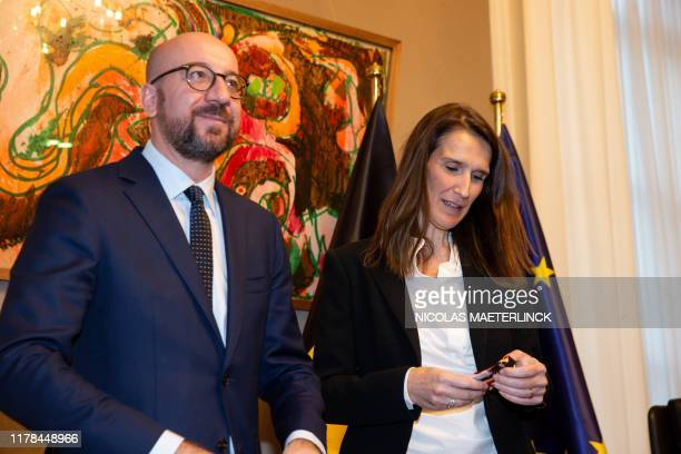 Belgian Prime Minister Charles Michel and Belgian Prime Minister Sophie Wilmes pictured during the passing of the power to the new Prime Minister in...