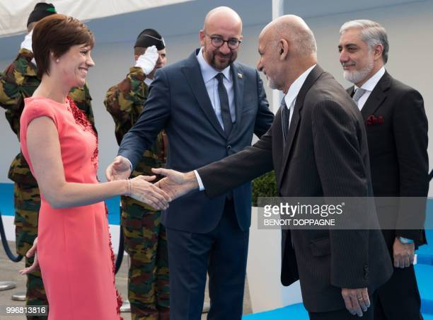 Belgian Prime Minister Charles Michel and his partner Amelie Derbaudrenghien greet Afghanistan's President Ashraf Ghani and Afghan Chief Executive...