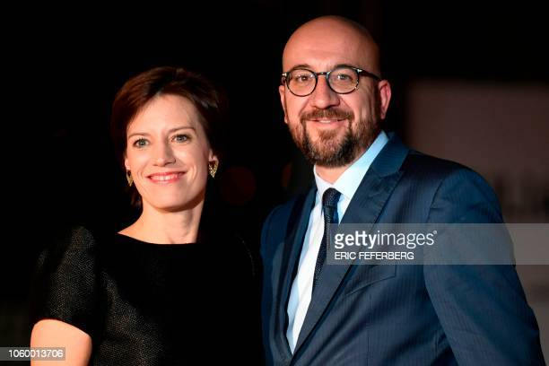 Belgian Prime Minister Charles Michel and his wife Amelie Derbaudrenghien arrive at the Musee d'Orsay in Paris on November 10 2018 to attend a state...