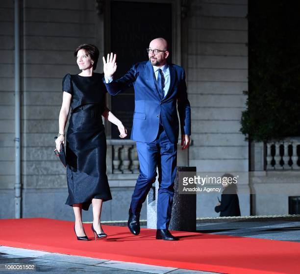Belgian Prime Minister Charles Michel and his wife Amelie Derbaudrenghien arrive at the official dinner on the eve of the international ceremony for...